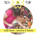 Woman selecting a product at a craft show