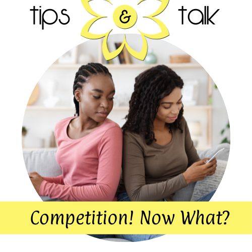 Women looking at the competition on a cell phone